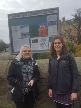 Helen Barbour and Anna Rowell in front of Murrayfield CC noticeboard on Old Colt Bridge.