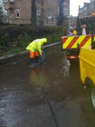 Pumping a gully clear on Roseburn Terrace
