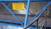 image of notice re litter on the water of leith footbridge